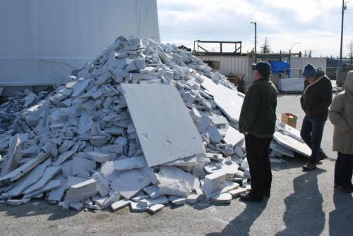 Lance in front of the scrap pile! Owner and host Tom Smith allowed us all to help ourselves!